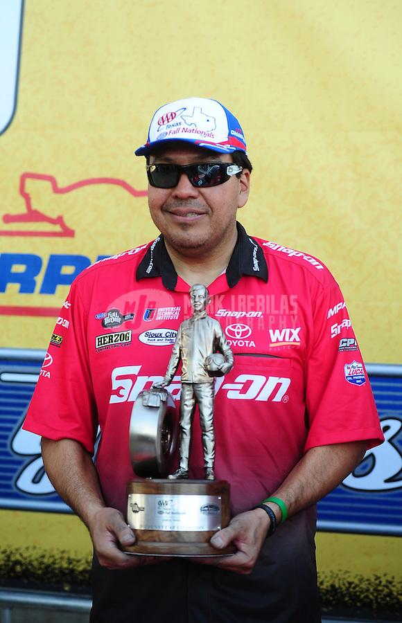 Sept. 25, 2011; Ennis, TX, USA: NHRA funny car driver Cruz Pedregon celebrates after winning the Fall Nationals at the Texas Motorplex. Mandatory Credit: Mark J. Rebilas-