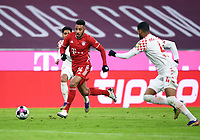 3rd January 2021, Allianz Arean, Munich Germany; Bundesliga Football, Bayern Munich versus FSV Mainz; Corentin Tolisso (Bayern Munich) breaks towards Jeremiah St. Juste (FSV Mainz 05)