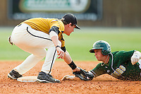 Second baseman Connor Mach #28 of the Missouri Tigers puts the tag on Justin Roland #16 of the Charlotte 49ers as he tries to steal second base at Robert and Mariam Hayes Stadium on February 27, 2011 in Charlotte, North Carolina.  Photo by Brian Westerholt / Four Seam Images