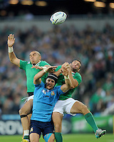 (L-R) Simon Zebo of Ireland, Michele Campagnaro of Italy and Dave Kearney of Ireland compete for the cross chip from Johnny Sexton of Ireland (not pictured) during Match 28 of the Rugby World Cup 2015 between Ireland and Italy - 04/10/2015 - Queen Elizabeth Olympic Park, London<br /> Mandatory Credit: Rob Munro/Stewart Communications