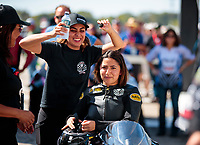 Oct 19, 2019; Ennis, TX, USA; NHRA pro stock motorcycle rider Jianna Salinas (right) with sister Jasmine Salinas during qualifying for the Fall Nationals at the Texas Motorplex. Mandatory Credit: Mark J. Rebilas-USA TODAY Sports