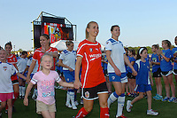 Heather Mitts of the Atlanta Beat leads her escort onto the pitch prior to the first game of the season.The Boston Breakers defeated the Atlanta Beat, 4-1, in Atlanta's home opener, Saturday, April 9, 2011.
