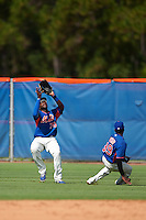 GCL Mets outfielder Kenneth Bautista (70) catches a fly ball as second baseman Cecilio Aybar (39) pulls off the play during the first game of a doubleheader against the GCL Marlins on July 24, 2015 at the St. Lucie Sports Complex in St. Lucie, Florida.  GCL Marlins defeated the GCL Mets 5-4.  (Mike Janes/Four Seam Images)