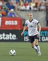 USWNT defender Becky Sauerbrunn  (4) looks to pass. In an international friendly, the U.S. Women's National Team (USWNT) (white/blue) defeated Korea Republic (South Korea) (red/blue), 4-1, at Gillette Stadium on June 15, 2013.