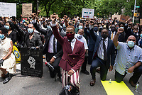 NEW YORK, NEW YORK - JUNE 04: Protesters march against the death of George Floyd and hold the funeral on June 4, 2020 in Harlem, New York. The white police officer, Derek Chauvin, has been charged with second-degree murder and further charges are pending for the three other officers who participated in the arrest. Floyd's death, the most recent in a series of deaths of black Americans at the hands of the police, has set off days and nights of protests across the country. (Photo by Joana Toro / VIEWpress via Getty Images)