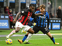 Football Soccer: Tim Cup Quarter Finals InternazionaleMIlan vs Milan, Giuseppe Meazza Stadium (San Siro) Milan, on January 26, 2021.<br /> Inter's Nicolò Barella (r) in action with Milan's Frank Kessie (l) during the Italian Tim Cup  football match between Inter  and Milan at the Giuseppe Meazza stadium in Milan, January 26, 2021.<br /> UPDATE IMAGES PRESS/Isabella Bonotto