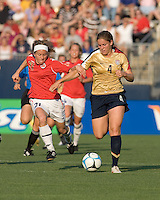 Cat Whitehill (United States, gold) breaks up field. The United States defeated Norway, 1-0, in Rentschler Stadium, July 14, 2007.