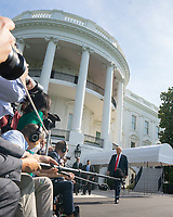 United States President Donald J. Trump walks towards members of the media on the South Lawn of the White House in Washington D.C., U.S., as he departs for Yuma, Arizona on Tuesday, June 23, 2020.  Trump stated that he authorized the Federal government to arrest any demonstrator caught vandalizing U.S. monuments, with a punishment of up to 10 years in prison.  Credit: Stefani Reynolds / CNP/AdMedia