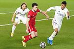 Real Madrid's Luka Modric (l) and Carlos Henrique Casemiro (r) and Liverpool FC's Diogo Jota during UEFA Champions League Quarter-finals 1st leg match. April 6,2021.(ALTERPHOTOS/Acero)