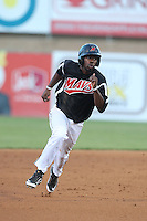 Travis Witherspoon #9 of the Visalia Rawhide runs the bases during a game against the High Desert Mavericks at Heritage Field on July 19, 2014 in Adelanto, California. Visalia defeated High Desert, 10-9. (Larry Goren/Four Seam Images)