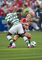 July 16, 2010 Marc Fortune No. 10 of Celtic FC and Paul Scholes No. 18 of Manchester United during an international friendly between Manchester United and Celtic FC at the Rogers Centre in Toronto.