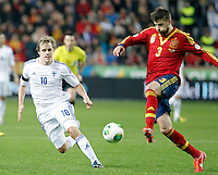 Spain's Gerard Pique (r) and Finland's Pukki during international match of the qualifiers for the FIFA World Cup Brazil 2014.March 22,2013.(ALTERPHOTOS/Victor Blanco)