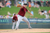 Starting pitcher Alex Panteliodis (20) of the Savannah Sand Gnats delivers a pitch in a game against the Greenville Drive on Sunday, August 24, 2014, at Fluor Field at the West End in Greenville, South Carolina. Greenville won, 8-5. (Tom Priddy/Four Seam Images)