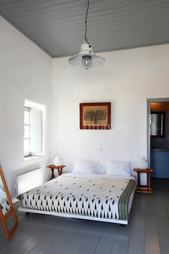 traditional bedroom with white washed walls