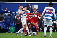 Queens Park Rangers' Rob Dickie reacts to being accidentally hit in the face by Middlesbrough's Britt Assombalonga<br /> <br /> Photographer Stephanie Meek/CameraSport<br /> <br /> The EFL Sky Bet Championship - Queens Park Rangers v Middlesbrough - Saturday 26th September 2020 - Loftus Road - London <br /> <br /> World Copyright © 2020 CameraSport. All rights reserved. 43 Linden Ave. Countesthorpe. Leicester. England. LE8 5PG - Tel: +44 (0) 116 277 4147 - admin@camerasport.com - www.camerasport.com