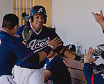 Reno Aces Juan Rivera gets a high five after hitting a two-run homerun against the Tacoma Rainiers in the fourth inning of their game played on Sunday afternoon, May 26, 2013 in Reno, Nevada.