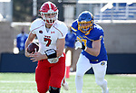 BROOKINGS, SD - MARCH 13: Mark Waid #7 of the Youngstown State Penguins looks for running room past Reece Winkelman #97 of the South Dakota State Jackrabbits at Dana J. Dykhouse Stadium on March 13, 2021 in Brookings, South Dakota. (Photo by Dave Eggen/Inertia)