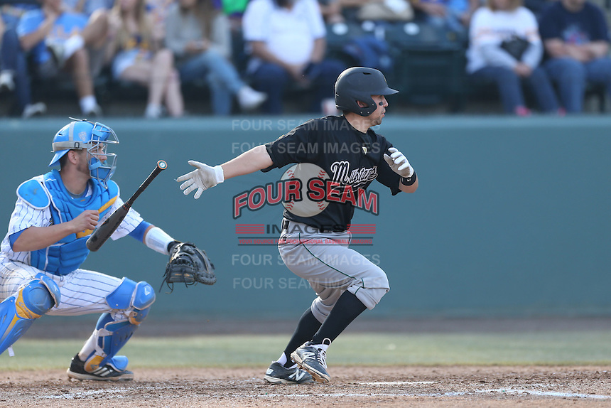 Peter Van Gansen #6 of the Cal Poly Mustangs bats in front of Shane Zeile #9 of the UCLA Bruins at Jackie Robinson Stadium on February 22, 2014 in Los Angeles, California. Cal Poly defeated UCLA, 8-0. (Larry Goren/Four Seam Images)