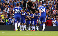 Pictured: Diego Costa of Chelsea mobbed by team mates celebrates his hat trick third goal. Saturday 13 September 2014<br /> Re: Premier League Chelsea FC v Swansea City FC at Stamford Bridge, London, UK.