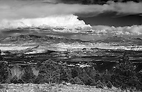 """""""Storm Over the<br /> Henry Mountains""""<br /> Dixie National Forest, Utah<br /> 2015<br /> <br /> A majestic landscape view from an overlook high up in the Dixie National Forest allows one to see Capitol Reef National Park and in the background, the Henry Mountains.  The storm over the mountains provided an interesting sky, but kept you wondering if it was heading your way.<br /> <br /> 4 x 5 Large Format Film"""