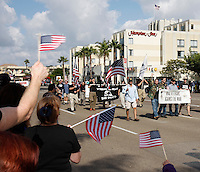Iraq Vetrans (from L) Derek Hess, Greg Nash, Jose Magana and Kenyon Ralph hold a sign as they march in the San Diego Veteran's Day San Diego California, Saturday November 10, 2007