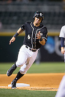 Neftali Soto (6) of the Charlotte Knights rounds third base during the game against the Columbus Clippers at BB&T BallPark on May 27, 2015 in Charlotte, North Carolina.  The Clippers defeated the Knights 9-3.  (Brian Westerholt/Four Seam Images)