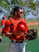 24 February 2012: Washington Nationals' catcher Jesus Flores takes a breather between pitching drills at the Carl Barger Baseball Complex in Viera, Florida. Mandatory Credit: Ed Wolfstein Photo