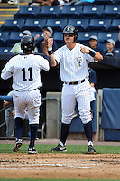 Staten Island Yankees infielder Saxon Butler (43) greets teammate Ravel Santana (11) during game against the Hudson Valley Renegades at Richmond County Bank Ballpark at St.George on June 24, 2012 in Staten Island, NY.  Staten Island defeated Hudson Valley 9-1.  Tomasso DeRosa/Four Seam Images