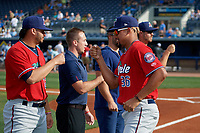 Fort Myers Miracle pitcher Jhoan Duran (36) fist bumps Melvi Acosta (left) during introductions before a Florida State League game against the Charlotte Stone Crabs on April 6, 2019 at Charlotte Sports Park in Port Charlotte, Florida.  Fort Myers defeated Charlotte 7-4.  (Mike Janes/Four Seam Images)