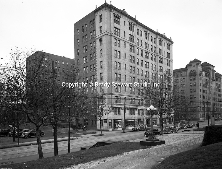 Pittsburgh PA:  View of the Arlington Apartments and Centre Avenue in Shadyside.  The apartments were built in the early 1900s and has businesses on the first floor; Arlington Pharmacy, Muller's Delicatessen, Arlington Coffee Shop, and Adell's Beauty Shop.