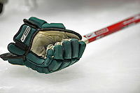 16 February 2008: A University of Vermont Catamount hockey glove and stick rest on the ice prior to a game against the Merrimack College Warriors at Gutterson Fieldhouse in Burlington, Vermont. The Catamounts defeated the Warriors 2-1 for their second win of the 2-game weekend series...Mandatory Photo Credit: Ed Wolfstein Photo