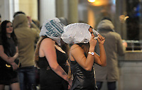 Pictured: Women cover themselves in plastic bags in the early hours of New Year's Day. Sunday 01 January 2017<br /> Re: Revellers out celebrating the New Year in the pub and club on Wind Street Swansea