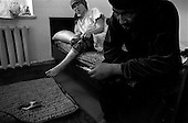 Osh, Krygystan.1996.Opium junkies in their Osh apartment. Police claim that the usage is a growing problem since the demise of the former Soviet Union. Economic conditions have created an atmposhere for intense drug trafficing.