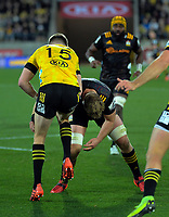 Chiefs Sam Cane tackles Hurricanes Jordie Barrett during the Super Rugby Aotearoa match between the Hurricanes and Chiefs at Sky Stadium in Wellington, New Zealand on Saturday, 8 August 2020. Photo: Dave Lintott / lintottphoto.co.nz