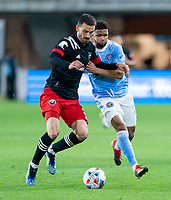 WASHINGTON, DC - APRIL 17: Brendan Hines-Ike #4 of D.C. United fights for the ball with Ismael Tajouri-Shradi #17 of New York City FC during a game between New York City FC and D.C. United at Audi Field on April 17, 2021 in Washington, DC.