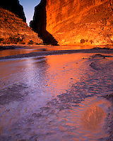 Sunrise glow and reflections in the Rio Grande River at Santa Elena Canyon; Big Bend National Park, TX