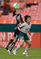 Sarah Huffman (14) of the Washington Freedom goes up for a header against Aya Miyama (6) of the Saint Louis Athletica at RFK Stadium in Washington, DC.  The Washington Freedom defeated Saint Louis Athletica, 3-1.