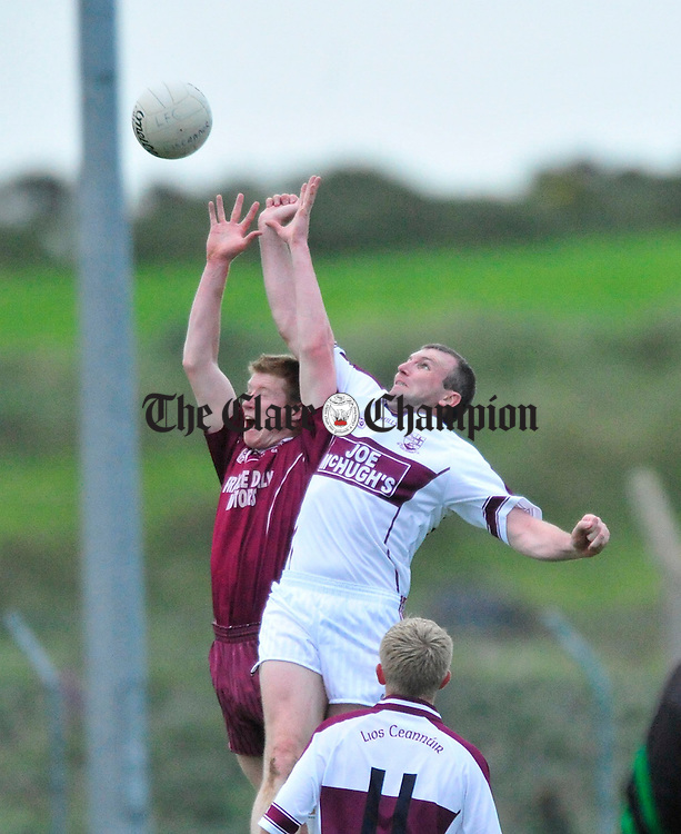 Derek Doohan of Lissycasey battles for posession with Liscannor's Brian Considine. Photograph by Declan Monaghan