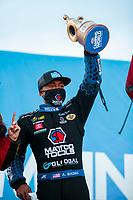 Nov 1, 2020; Las Vegas, Nevada, USA; NHRA top fuel driver Antron Brown celebrates after winning the NHRA Finals at The Strip at Las Vegas Motor Speedway. Mandatory Credit: Mark J. Rebilas-USA TODAY Sports