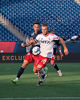FOXBOROUGH, MA - JUNE 26: Collin Verfurth #35 of the New England Revolution pressures Alex Bruce #28 of North Texas SC during a game between North Texas SC and New England Revolution II at Gillette Stadium on June 26, 2021 in Foxborough, Massachusetts.