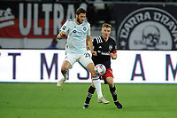 WASHINGTON, DC - MAY 13: Elliot Collier #28 of Chicago Fire FC battles for the ball with Julian Gressel #31 of D.C. United during a game between Chicago Fire FC and D.C. United at Audi FIeld on May 13, 2021 in Washington, DC.