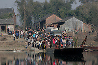 Farmers take a ferry across the Xiang River on their way to the market on the last market day before the Chinese New Year at a town near Quanzhou, Guangxi Province, China..27 Jan 2006