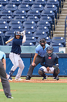 Lakeland Flying Tigers catcher Gresuan Silverio (51) bats during a game against the Tampa Tarpons on July 18, 2021 at George M. Steinbrenner Field in Tampa, Florida.  Also shown, catcher Carlos Narvaez (5) and umpire Michael Corbett.  (Mike Janes/Four Seam Images)