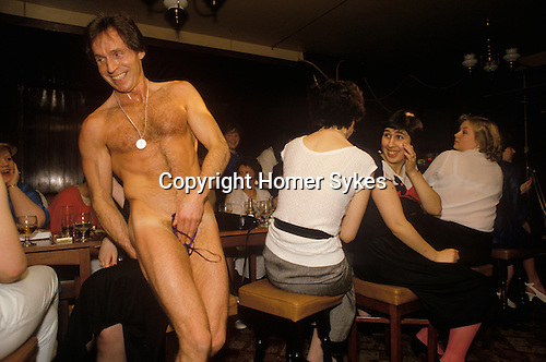 South London. 1980's<br /> Medallion man Brian Jason, aka King Dick, performs in the Duke of Cambridge pub; it's a girl's night only hen party.