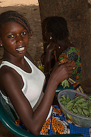 Woman in Western-style Blouse Sorting Greens, Nixo Village, near Sokone, Senegal.  Note Nose Pin.