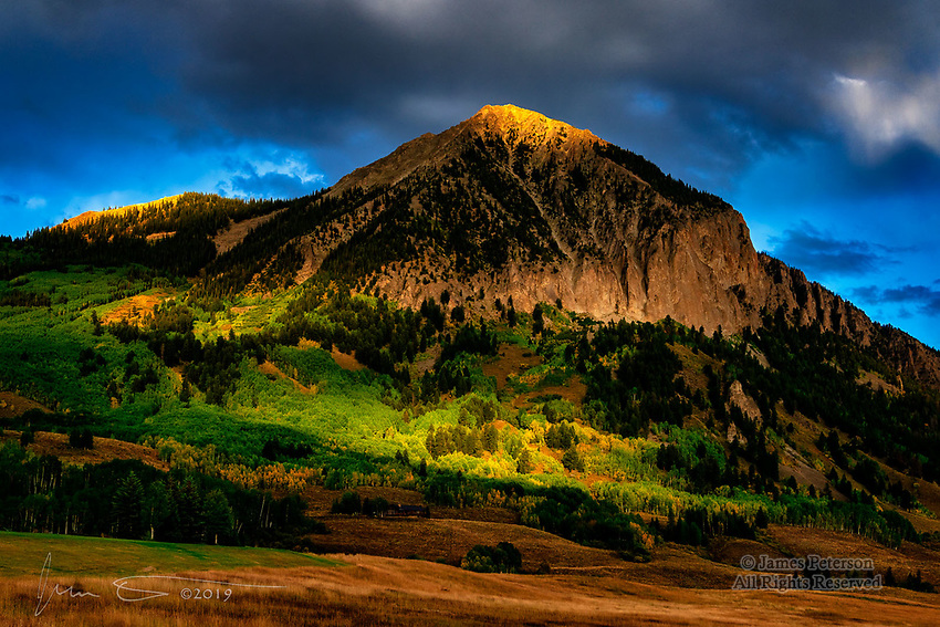 Sunset Light on Crested Butte.  Broken clouds on a late summer afternoon painted this Colorado landmark with beams of sublime light.<br /> <br /> Image ©2019 James D Peterson