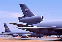 US Air Force Military Aircraft on Static Display - at Abbotsford International Airshow, BC, British Columbia, Canada - McDonnell Douglas KC-10 Extender in foreground, and Boeing KC-135 Stratotanker in background
