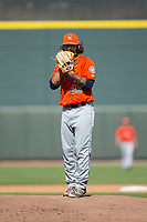 Buies Creek Astros relief pitcher Ralph Garza (26) looks to his catcher for the sign against the Winston-Salem Dash at BB&T Ballpark on April 16, 2017 in Winston-Salem, North Carolina.  The Dash defeated the Astros 6-2.  (Brian Westerholt/Four Seam Images)
