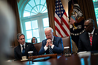 United States President Joe Biden speaks as US Secretary of State Antony Blinken, left, and US Secretary of Defense Lloyd J. Austin III, right, listen during a cabinet meeting at the White House in Washington, D.C., U.S., on Tuesday, July 20, 2021. Biden administration officials say they're starting to see signs of relief for the global semiconductor supply shortage, including commitments from manufacturers to make more automotive-grade chips for car companies. <br /> CAP/MPI/RS<br /> ©RS/MPI/Capital Pictures