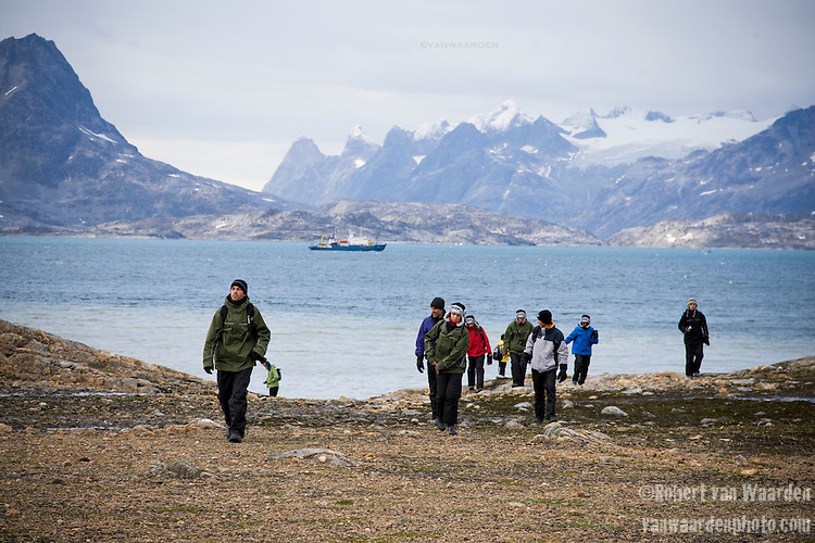 Students of the Cape Farewell Youth Expedition, organized by the British Council of Canada, explore the coast of Greenland while the ship waits in the background.
